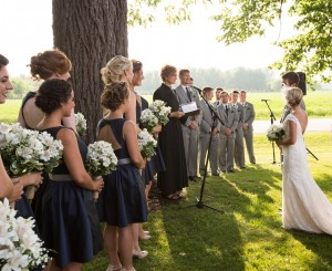 Valerie and Justin say their vows beneath the black walnut tree on Saxon Homestead Farm.