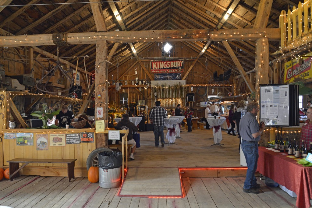 Guests stroll around the decorated barn at our annual barn dance.