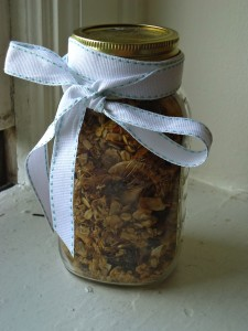 A jar of healthful granola made with our maple syrup rests on a windowsill.