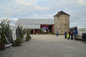 Guests excitedly stroll to the historic bar for the annual barn dance fundraiser.
