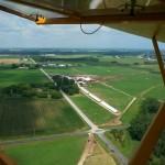 An aerial view of Saxon Homestead Farm from a Super Cub airplane.